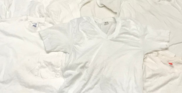 A pile of vintage white t-shirts